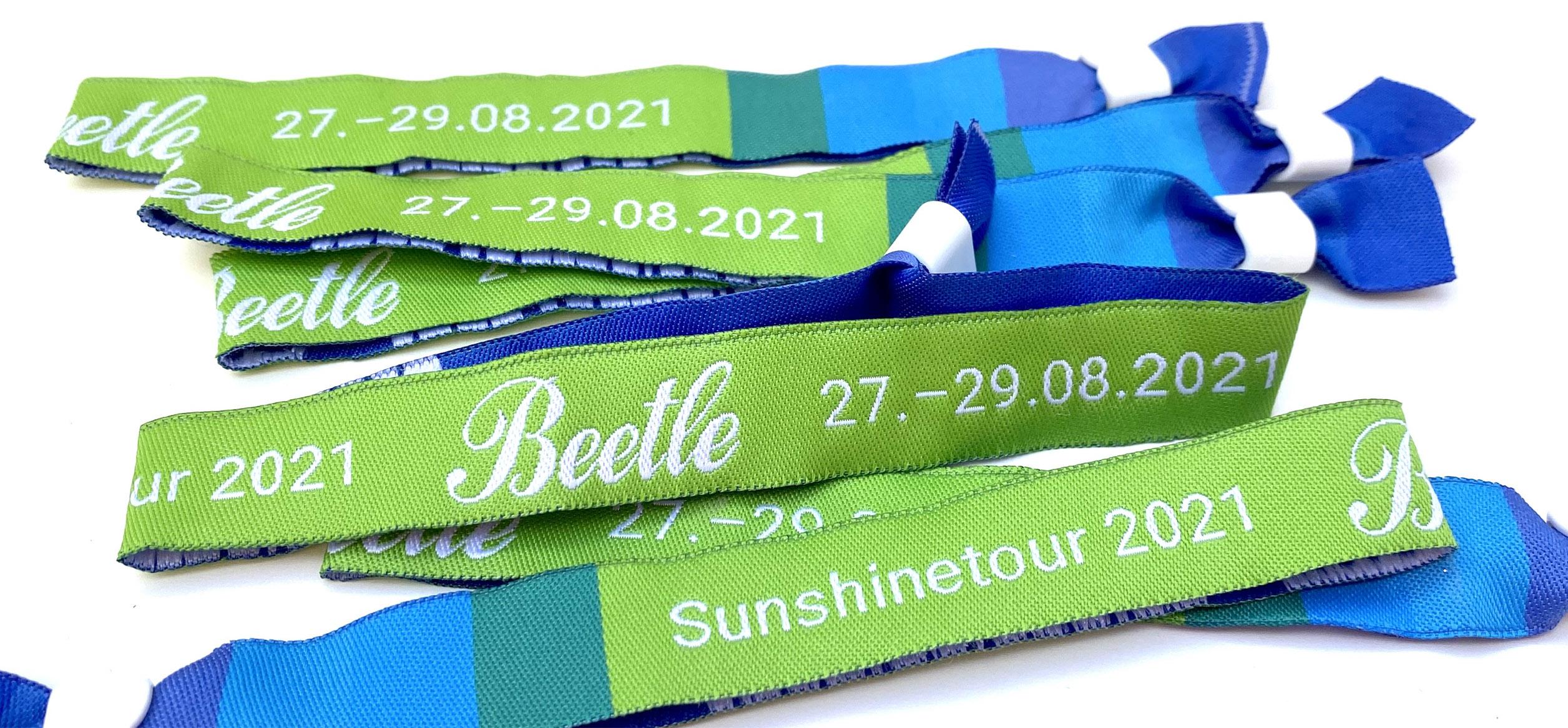 Die Tour-Bändchen und das Motto 2021